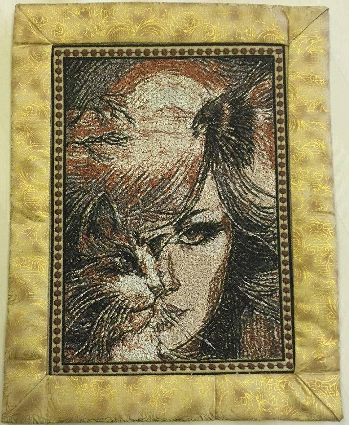 Cat woman on carpet photo stitch free embroidery design
