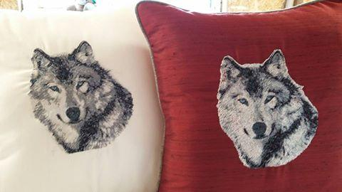 Embroidered pillows with wolf photo stitch design