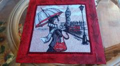 Embroidered design with lady and umbrella