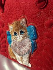Kitten with bow machine embroidery design at bag