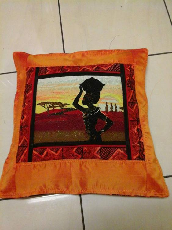 Cushion with African Lady free embroidery design
