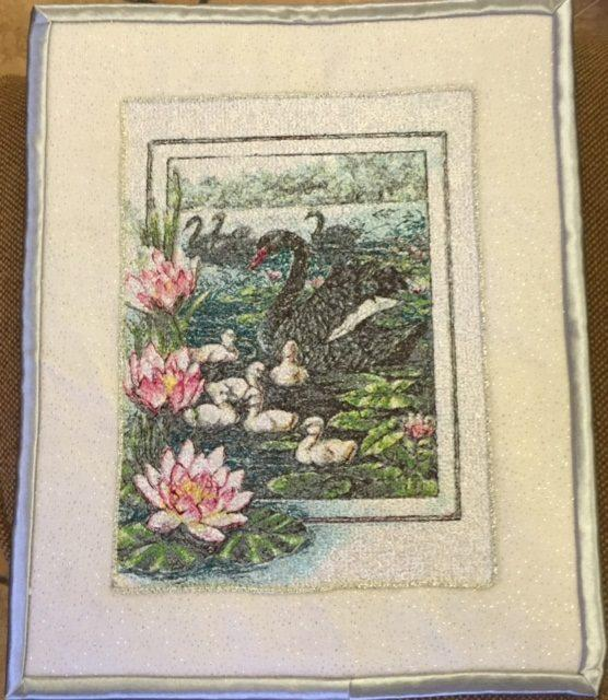 Embroidered black swans photo stitch design