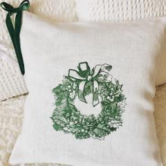 Sofa cushion with Christmas wreath embroidery design