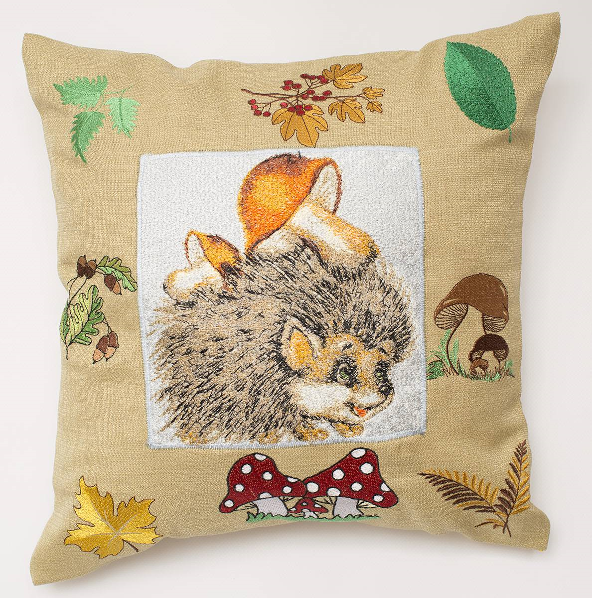 Embroidered cushion with hedgehog photo stitch design