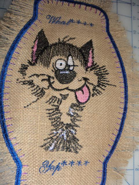 Embroidered towel with strange cat