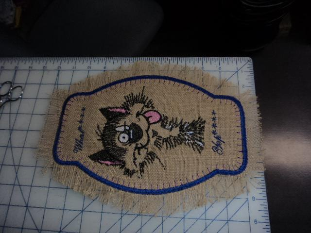 Towel with strange cat free embroidery design