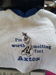 Towel with Happy Olaf embroidery design