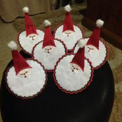 Dressed Santa serviettes up for table