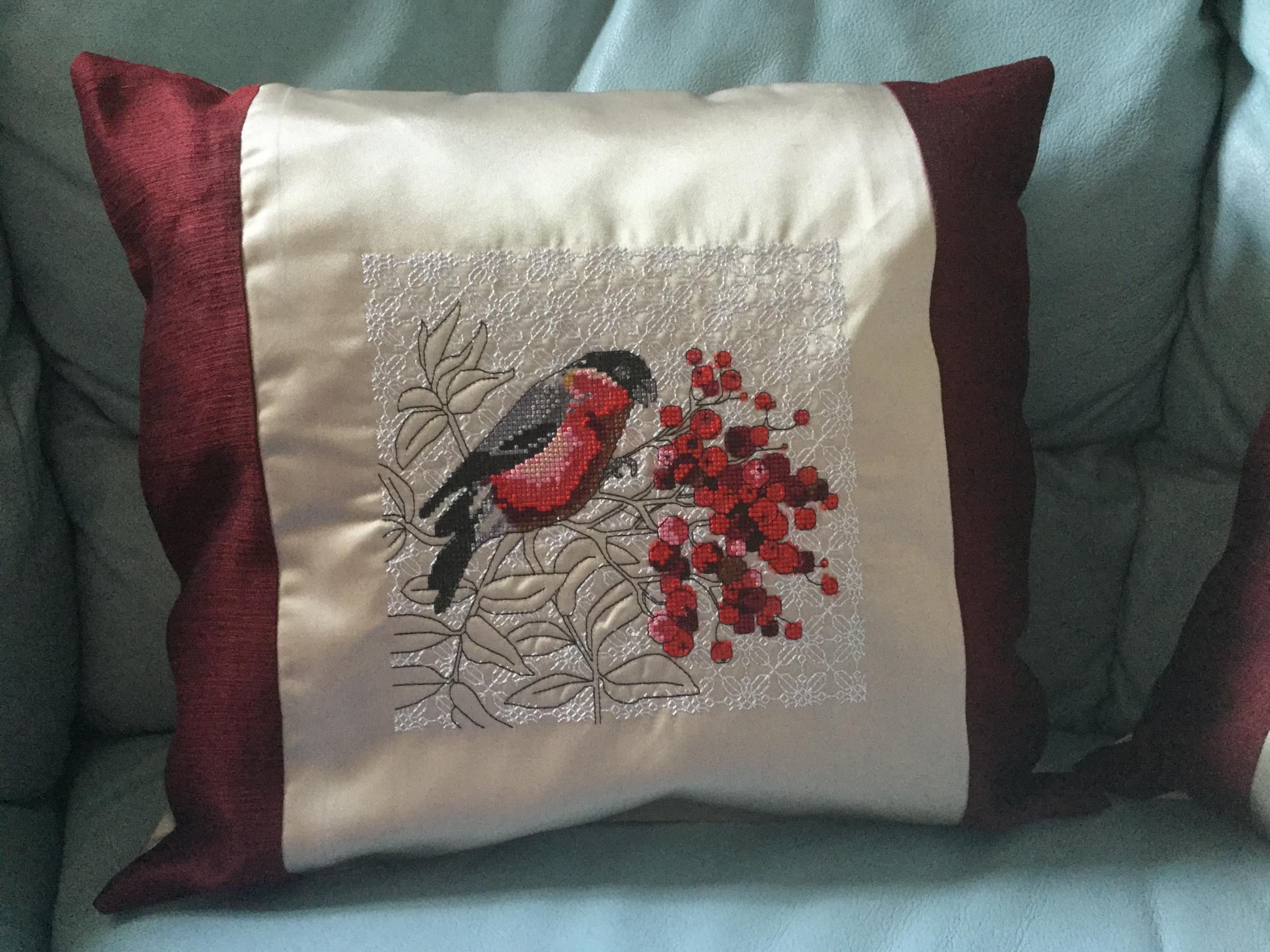 Embroidered cushion with bullfinch cross stitch design