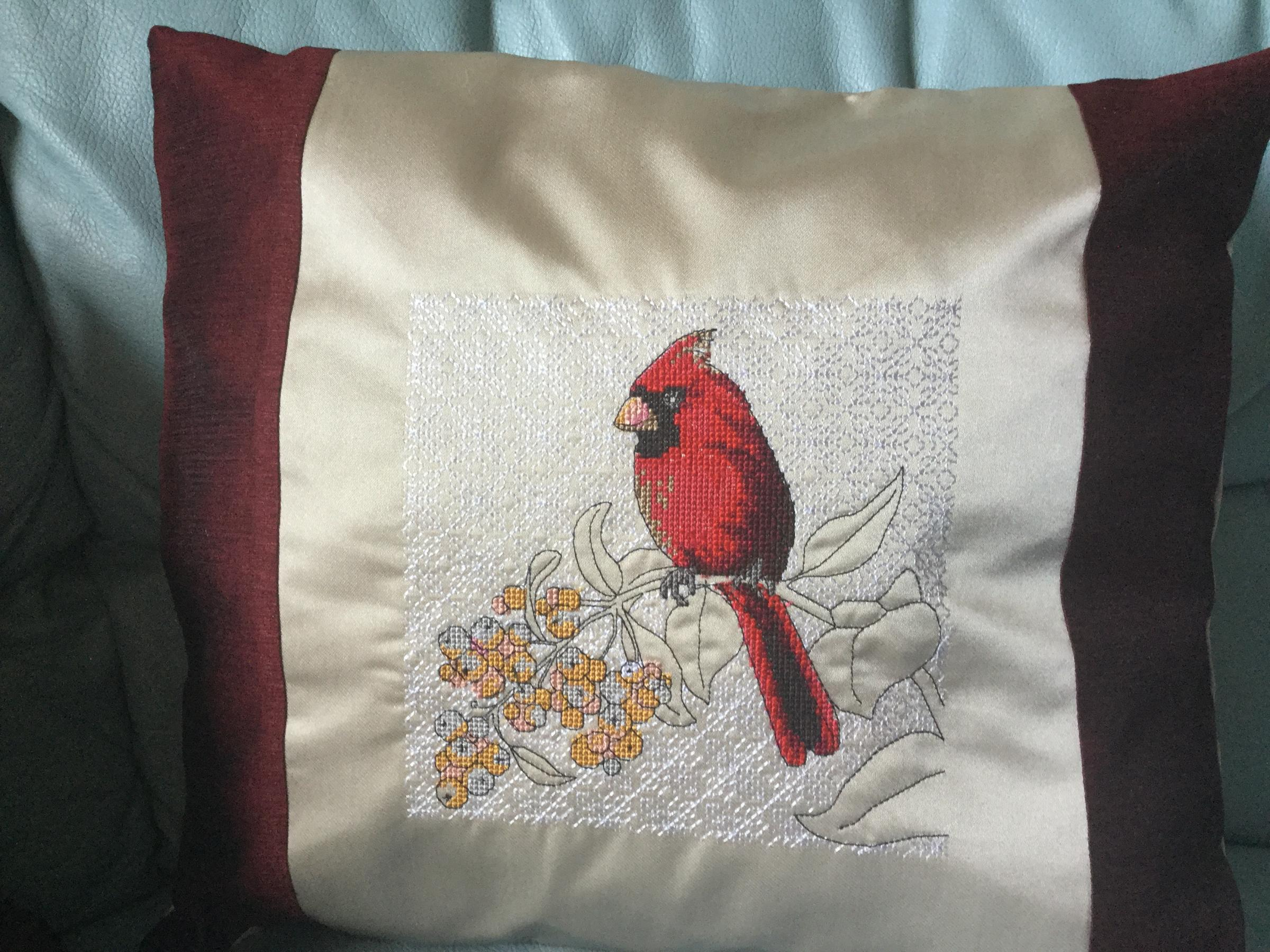Embroidered cushion with Cardinal cross stitch free design