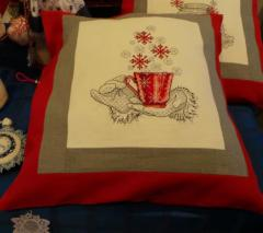 Cushion with a cup full of Christmas wishes cross stitch free embroidery design