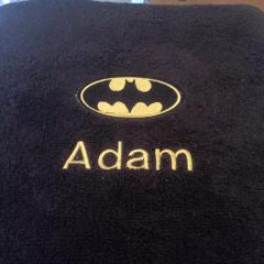 Bathroom towel with Batman logo embroidery design