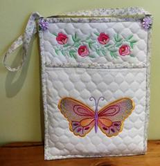 Textile organizer with flowers and butterfly
