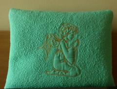 Sofa cushion with Little Angel machine embroidery design