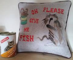 sofa cushion with sneaky cat free machine embroidery design