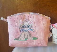 Cosmetic bag with kitty free embroidery design