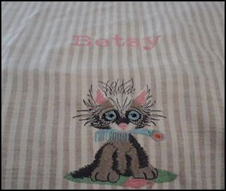 Betsy cat with comb.JPG