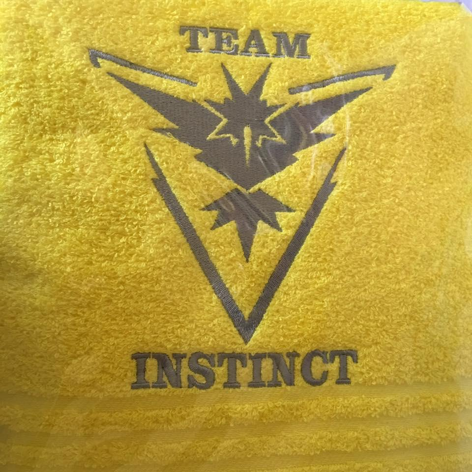 Towel with Pokemon Go Team Instinct embroidery design