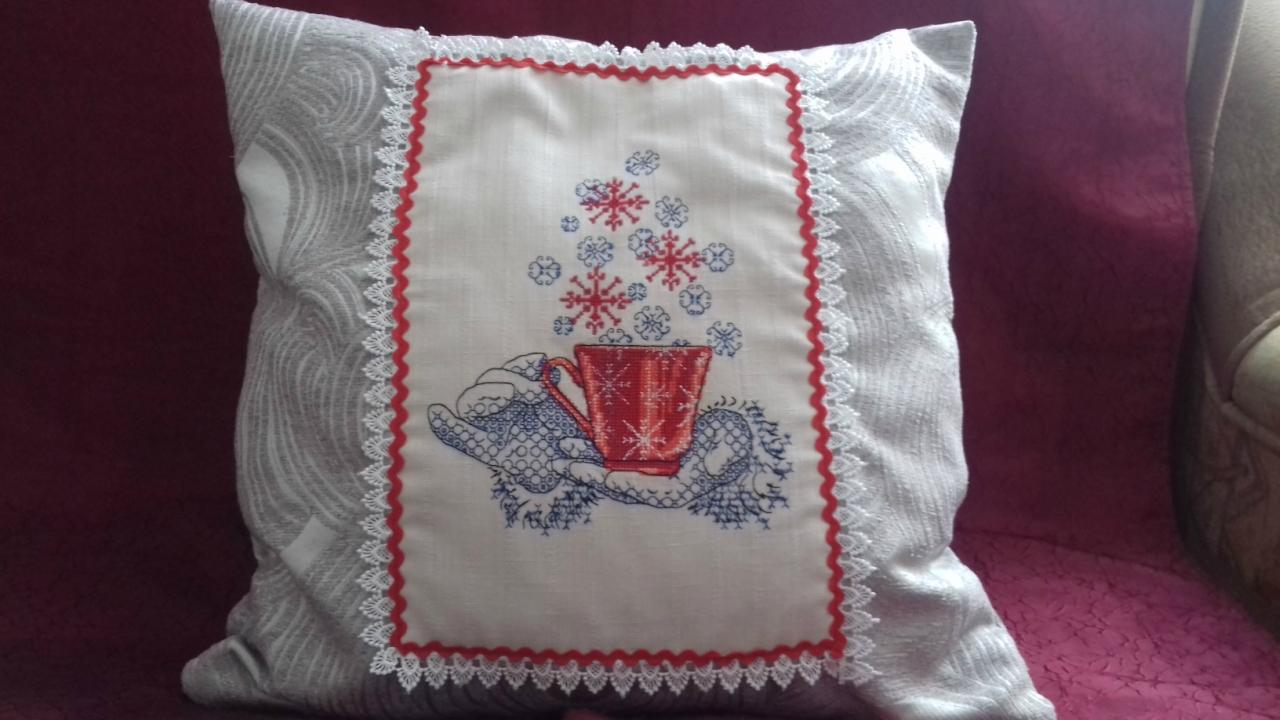 Embroidered cushion with cross stitch design