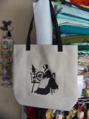 Embroidered bag with distaff cross stitch design