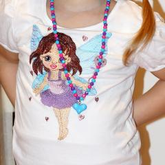 Girl's shirt with Baby love fairy embroidery design