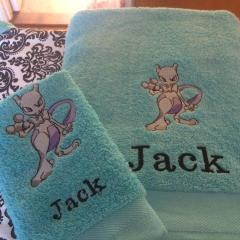 Towel with Mewtwo embroidery design