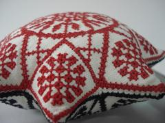 Small sewing pillow with red star cross stitch embroidery design