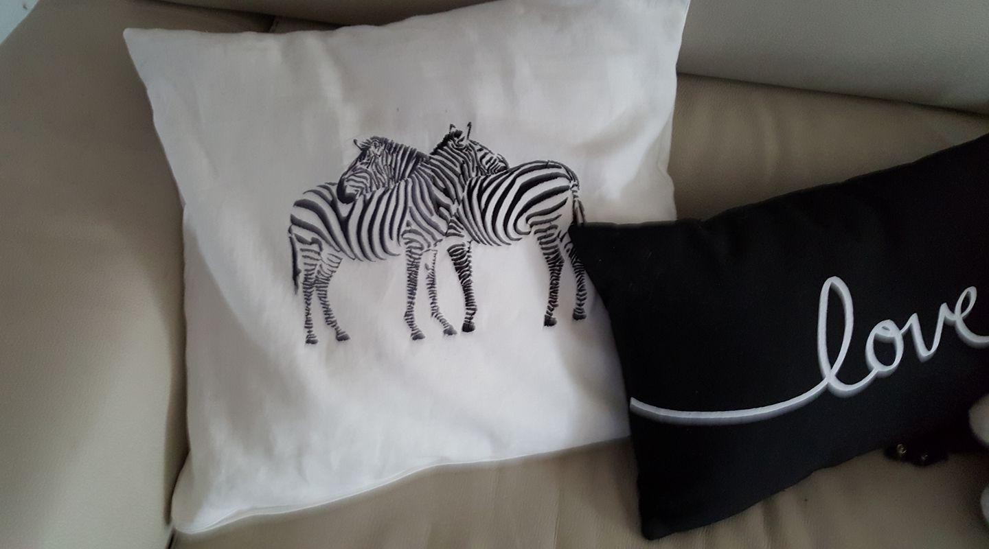 Embroidered cushion with zebra free design