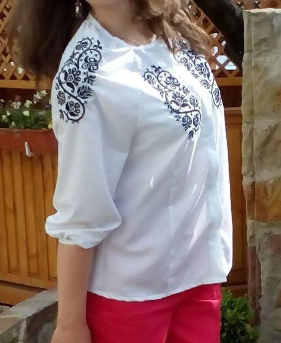 Woman's blouse with cross stitch free embroidery decoration