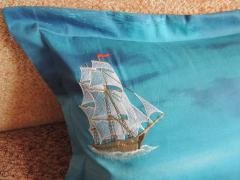 Cushion with sea ship free embroidery design