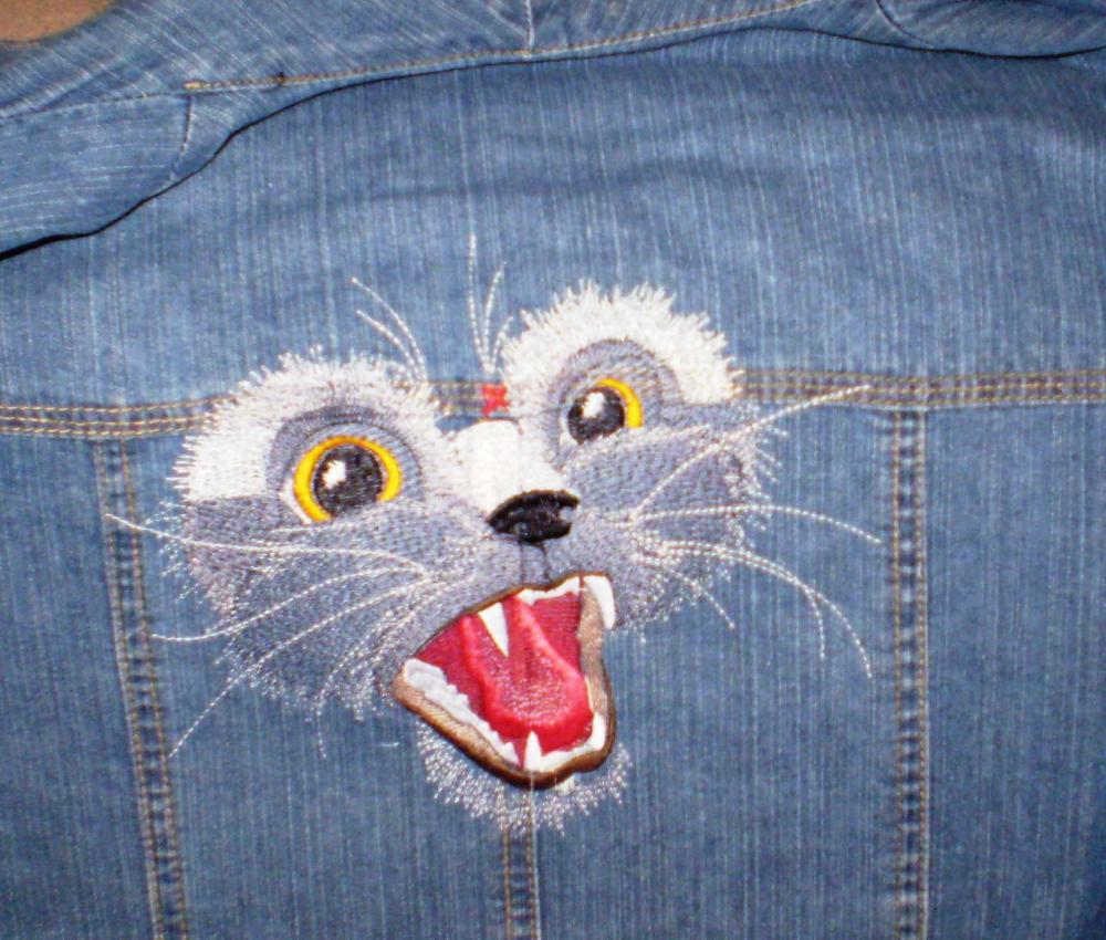 Denim pants with kitten free embroidery design