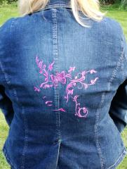 Woman and Butterfly free embroidery design on denim Jacket