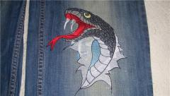 Denim fabric piece with Snakes bite embroidery design