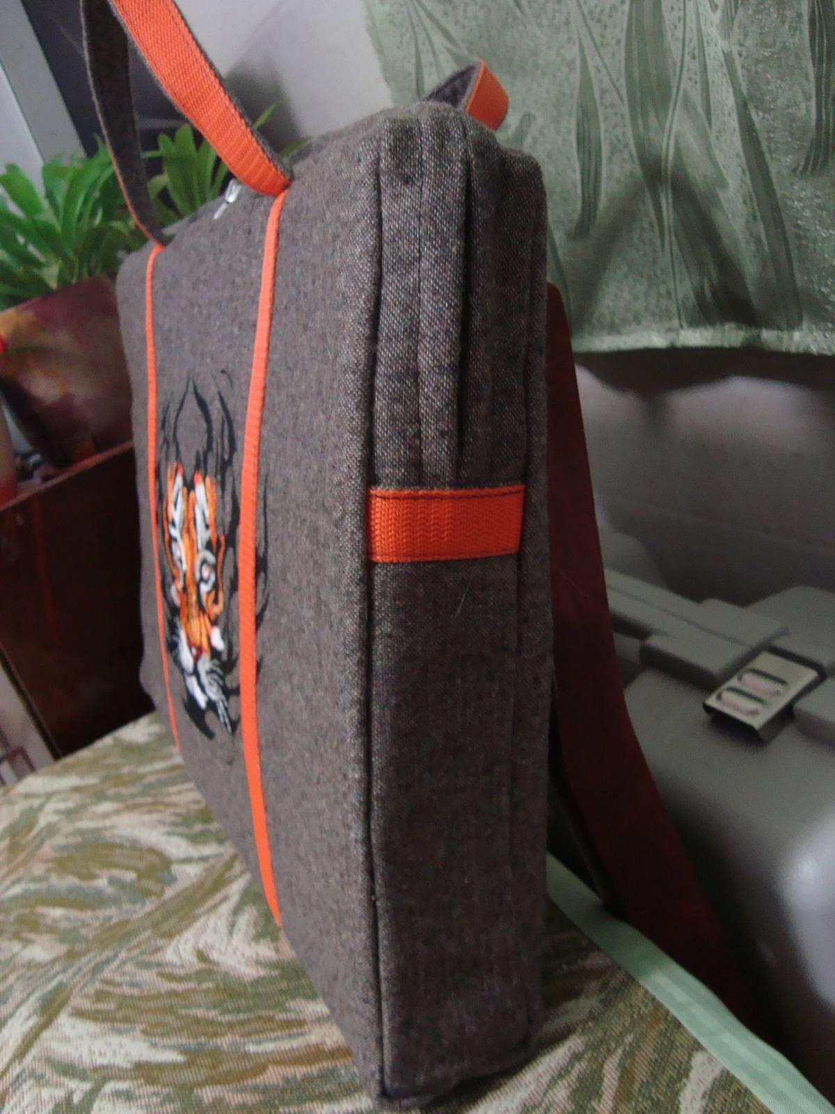 A laptop bag decorated with tribal tiger machine embroidery design