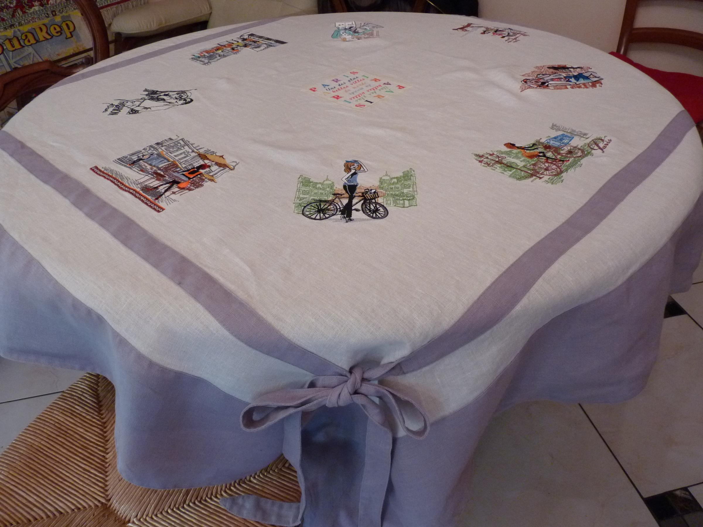 Embroidered tablecloth with city view designs