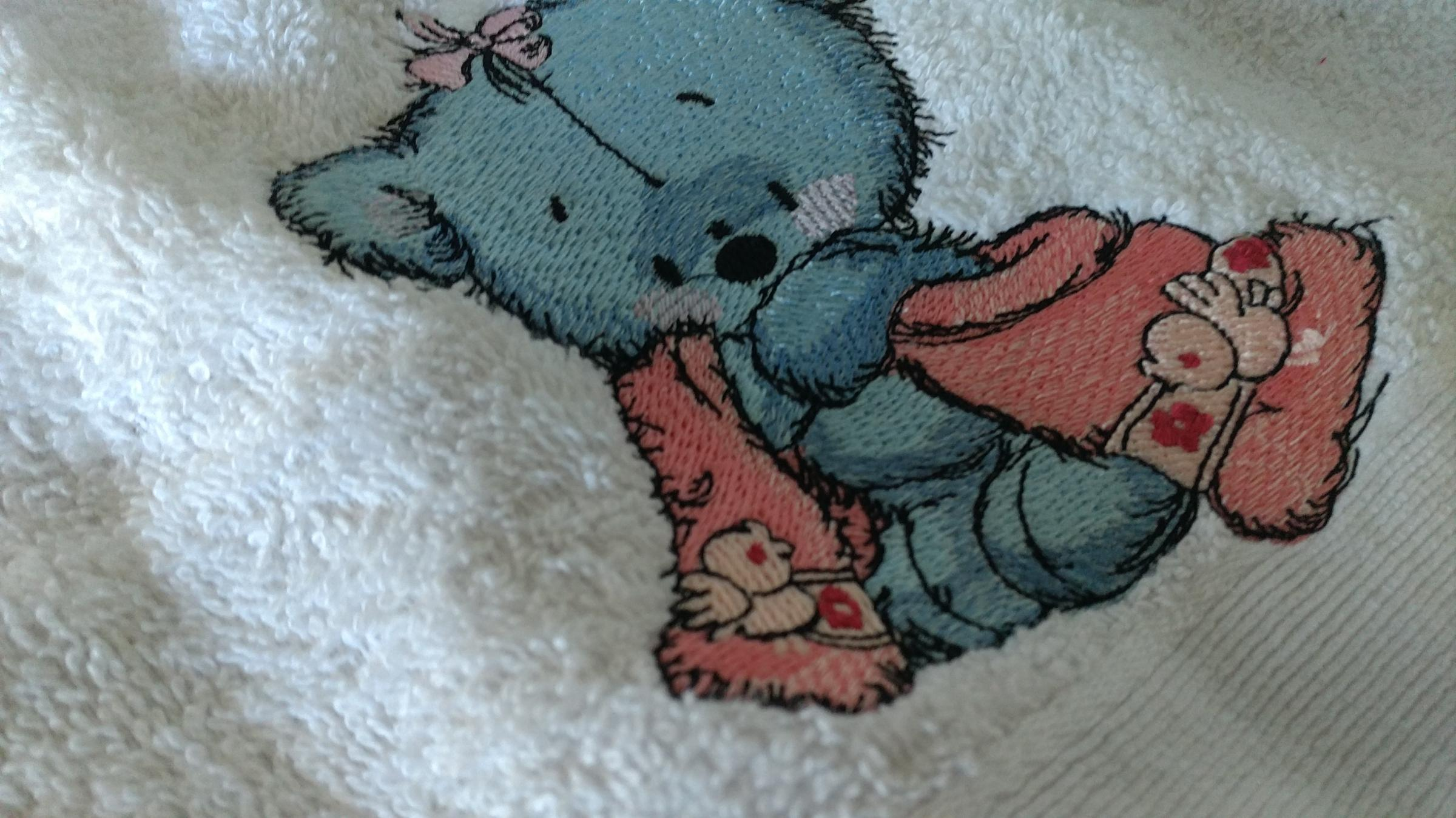Embroidered bath towel with teddy bear after shower