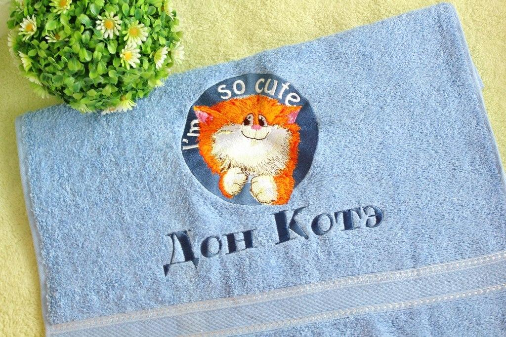 Embroidered towel with cute cat design