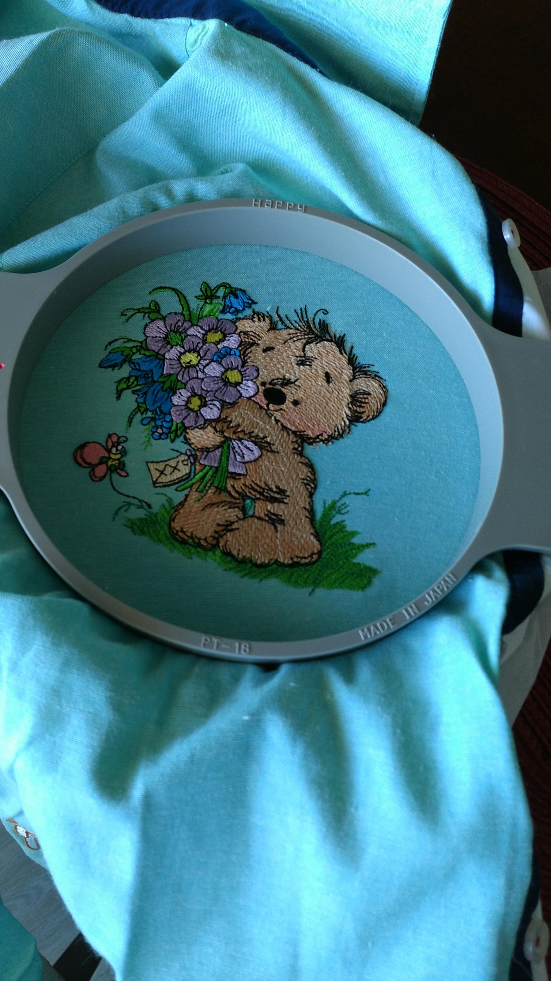 Finished cute teddy bear with flowers embroidery design