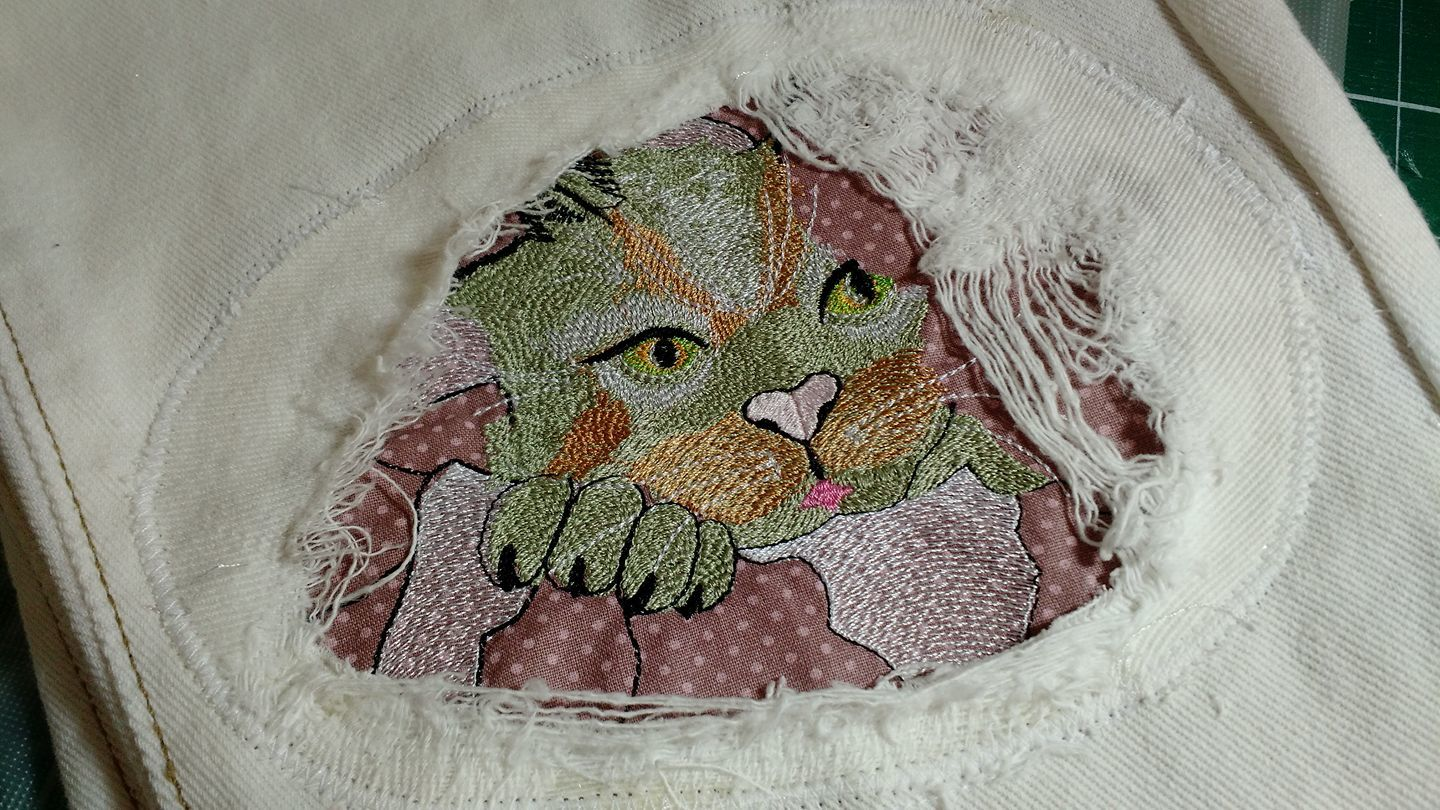 Denim patch with angry cat free embroidery design