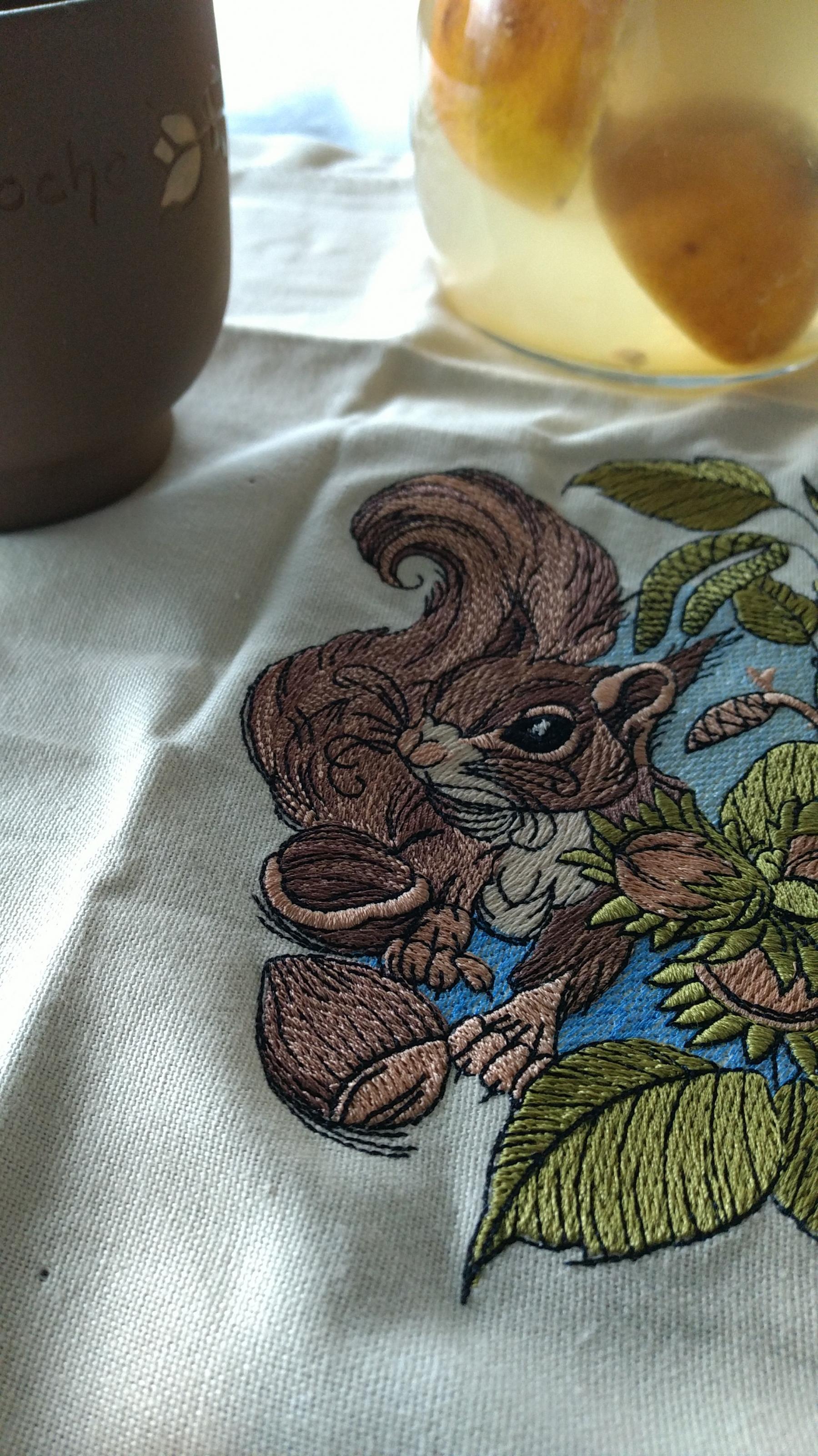 Squirrel with hazelnut embroidery napkin