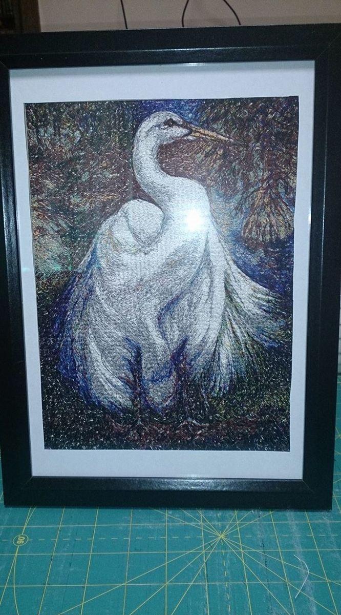 Stork embroidery framed