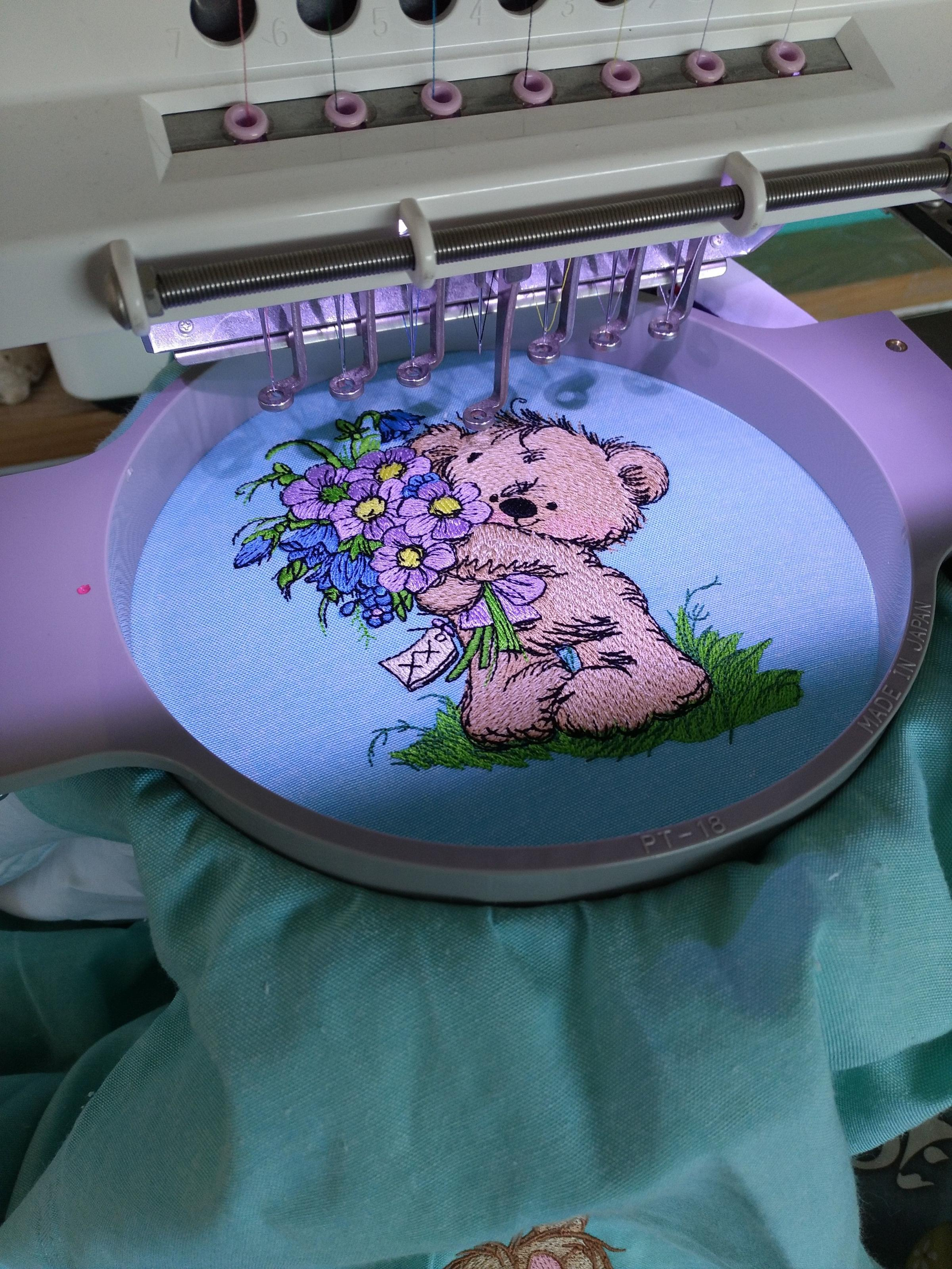 Teddy bear with bouquet embroidery design