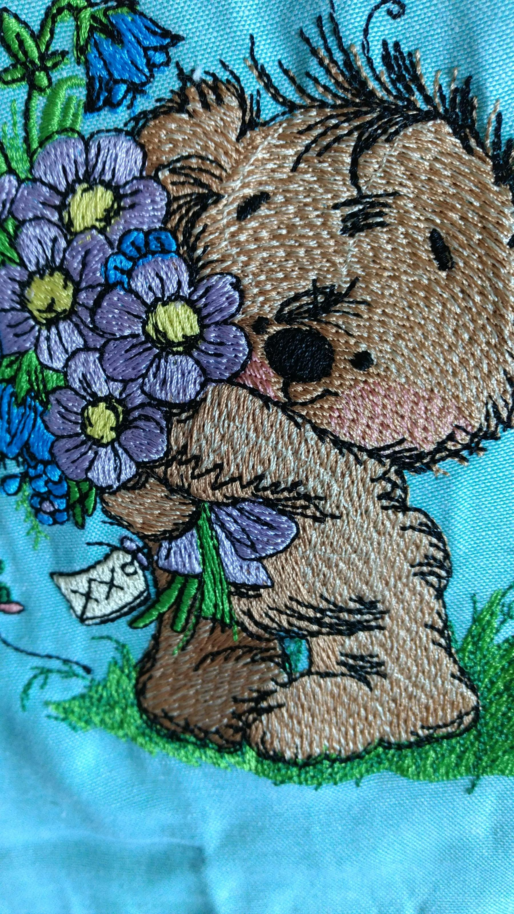 Finished Teddy bear with bouquet for you machine embroidery design