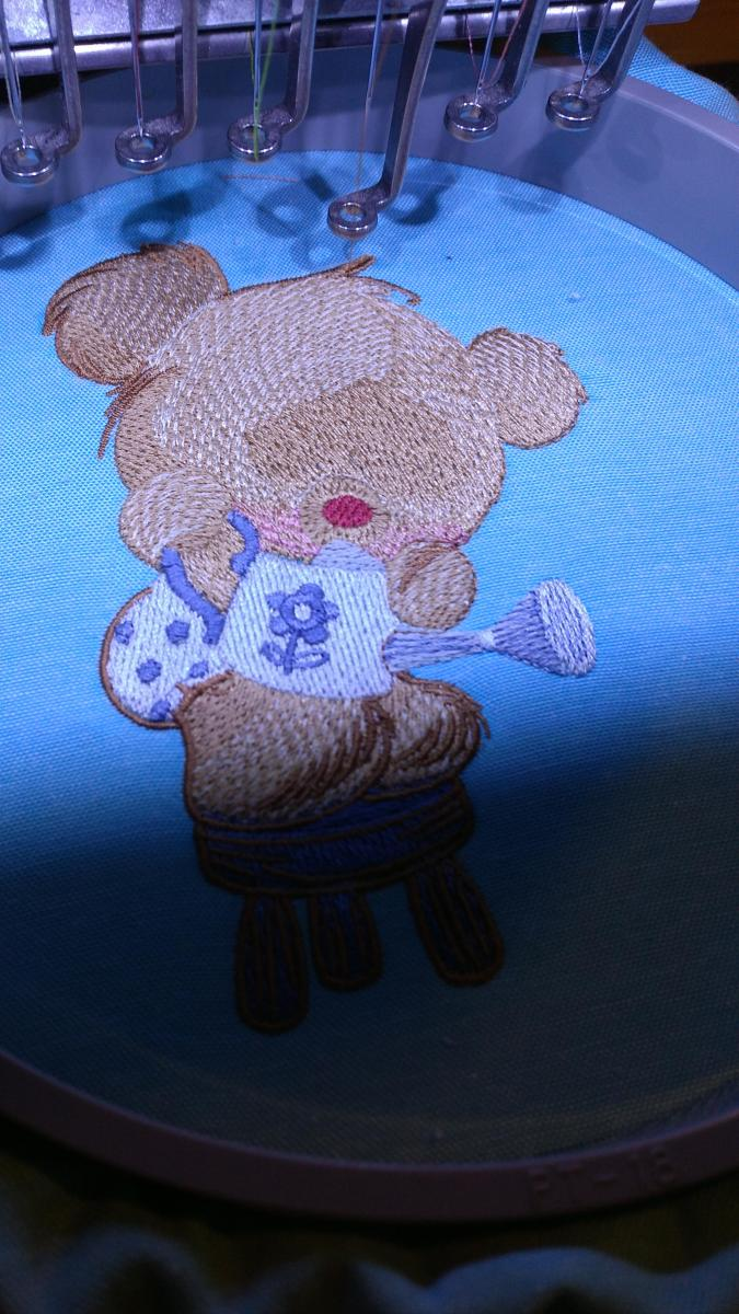 Teddy bear in embroidery hoop
