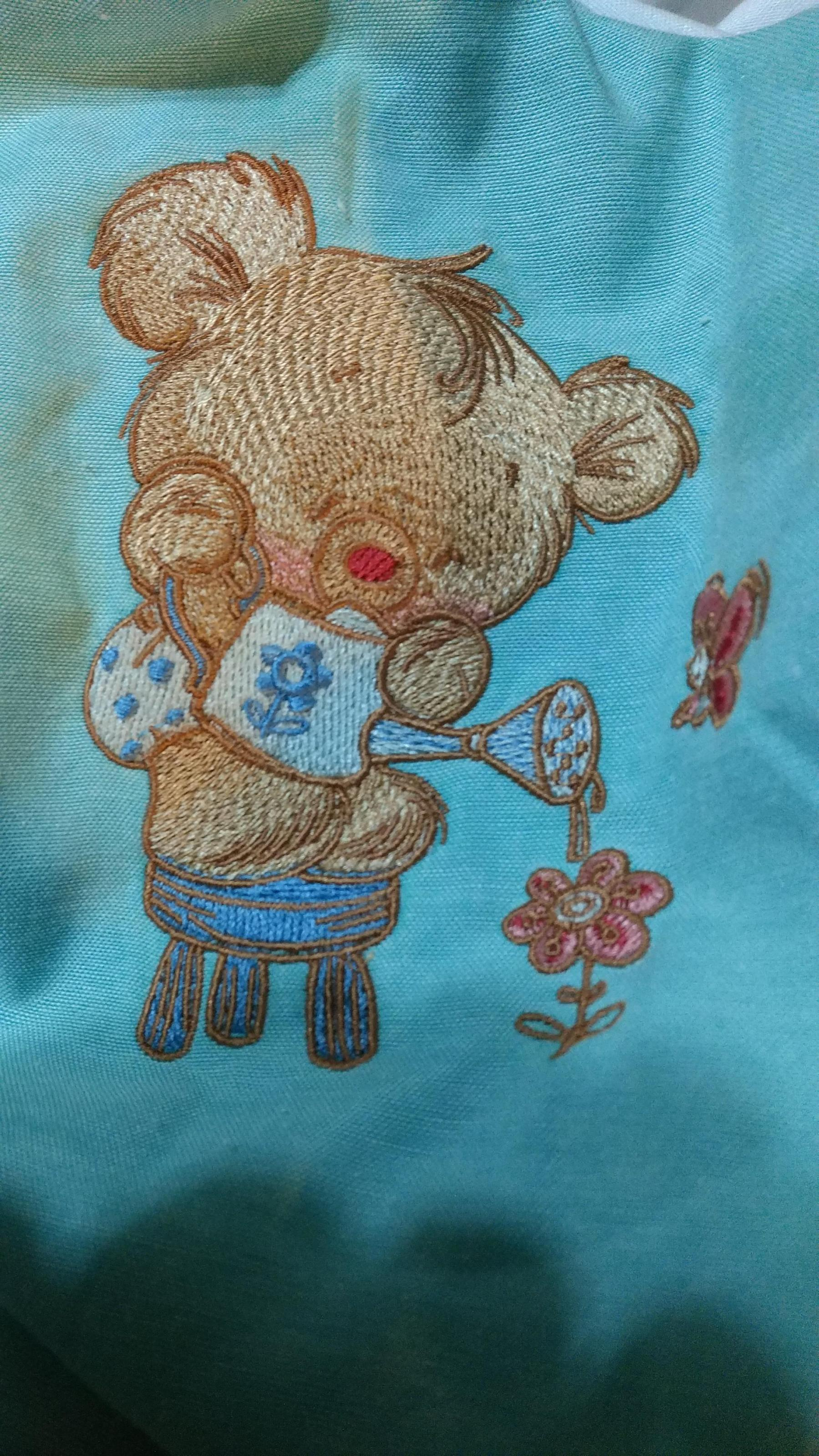 Finished Teddy bear watering can embroidery design