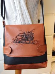 Leather handbag with Curious cat machine embroidery design