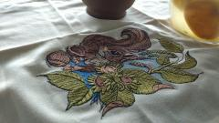 Embroidered napkin with squirrel with hazelnut design