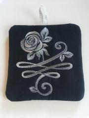 Potholder with rose free machine embroidery design