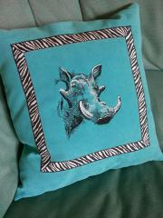 Cushion with rhino embroidery design