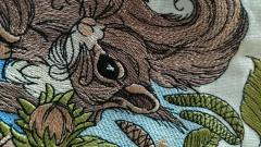 Squirrel machine embroidery design at kitchen napkin